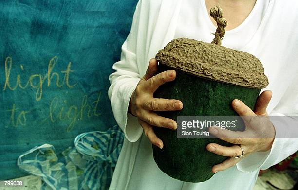 Designer Hazel Selina displays her ecofriendly ''Acorn'' a container for cremated ashes April 8 2001 at the ''Day for the Dead'' event at The Natural...