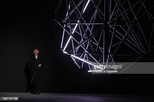 Designer Hedi Slimane walks the runway during the finale of the Celine Menswear Fall/Winter 20192020 show as part of Paris Fashion Week on January 20...