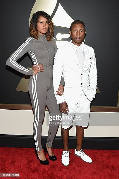 Designer Helen Lasichanh and recording artist/producer Pharrell Williams attend The 57th Annual GRAMMY Awards at the STAPLES Center on February 8...