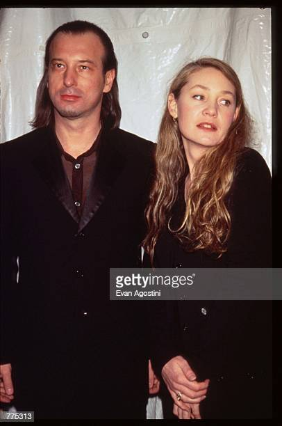 Designer Helmut Lang stands next to an unidentified woman at the Louis Vuitton Centennial Masked Ball February 15 1996 in New York City The...