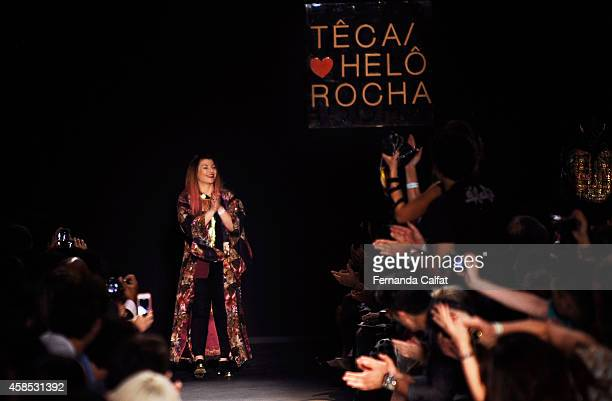 Designer Helo Rocha acknowledges the crowd on the runway at the Teca por Helo Rocha fashion show during Sao Paulo Fashion Week Winter 2015 at Parque...