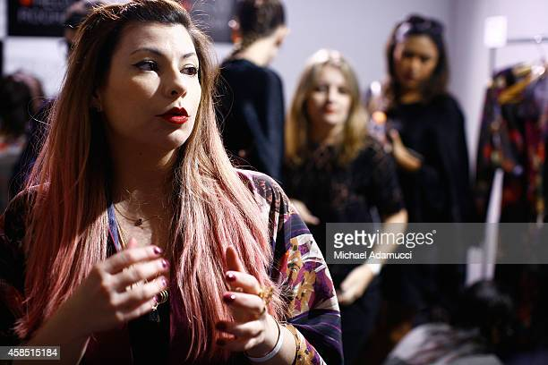 Designer Helo Rocha gives an interview backstage before the Teca por Helo Rocha fashion show during Sao Paulo Fashion Week Winter 2015 at Parque...