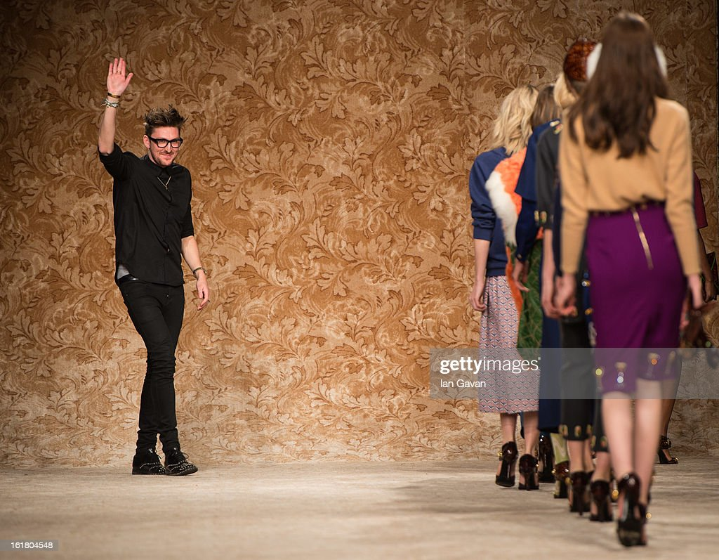 Designer Henry Holland appears on the runway after the House of Holland show during London Fashion Week Fall/Winter 2013/14 at Brewer Street Car Park on February 16, 2013 in London, England.