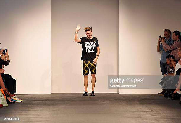 Designer Henry Holland walks the catwalk during his House Of Holland show on day 2 of London Fashion Week Spring/Summer 2013 at Brewer St Car Park on...