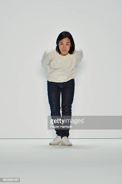 Designer Hien Le acknowledges the audience at the Hien Le show during MercedesBenz Fashion Week Autumn/Winter 2014/15 at Brandenburg Gate on January...