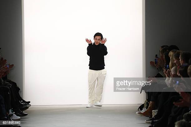 Designer Hien Le acknowledges the audience following his show during the MercedesBenz Fashion Week Berlin A/W 2017 at Kaufhaus Jandorf on January 17...