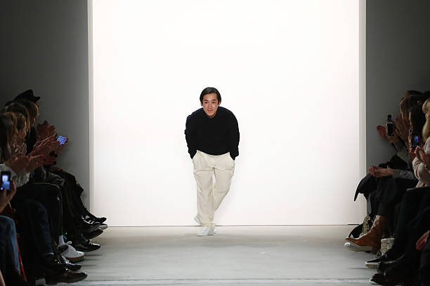 f38ea71156b6 Designer Hien Le acknowledges the audience following his show during the  Mercedes-Benz Fashion Week