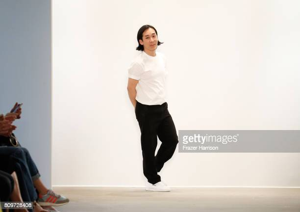Designer Hien Le acknowledges the audience following his show during the during the MercedesBenz Fashion Week Berlin Spring/Summer 2018 at Kaufhaus...