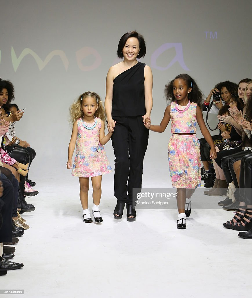 Designer HJ Chung (C) walks the runway with models during the Imoga preview at petitePARADE / Kids Fashion Week at Bathhouse Studios on October 18, 2014 in New York City.