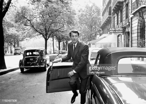 Designer Hubert De Givenchy is stepping out of the Mercedes car in front of his Paris Showroom. He is out of the car running very elegantly looking...