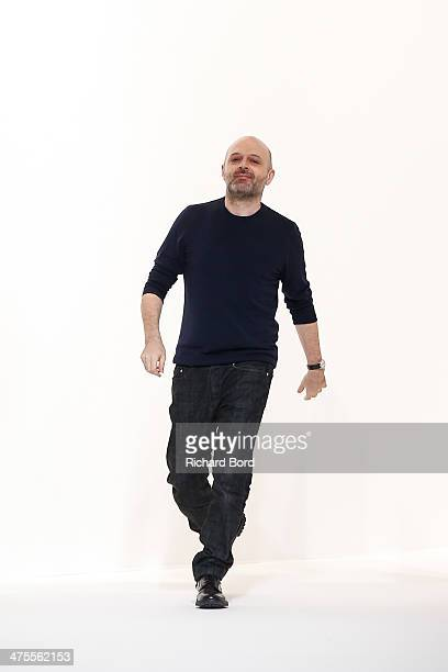Designer Hussein Chalayan walks the runway after the Chalayan show as part of the Paris Fashion Week Womenswear Fall/Winter 20142015 at Les Beaux...