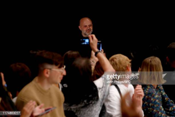Designer Hussein Chalayan walks the runway at the Chalayan show during London Fashion Week September 2019 at Sadlers Wells Theatre on September 15,...