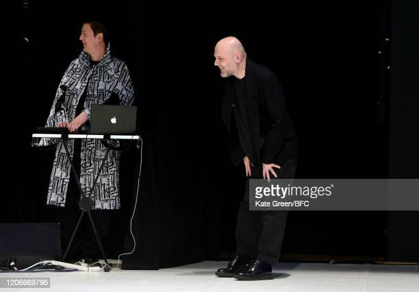 Designer Hussein Chalayan walks the runway at the finale of his show during London Fashion Week February 2020 on February 16, 2020 in London, England.