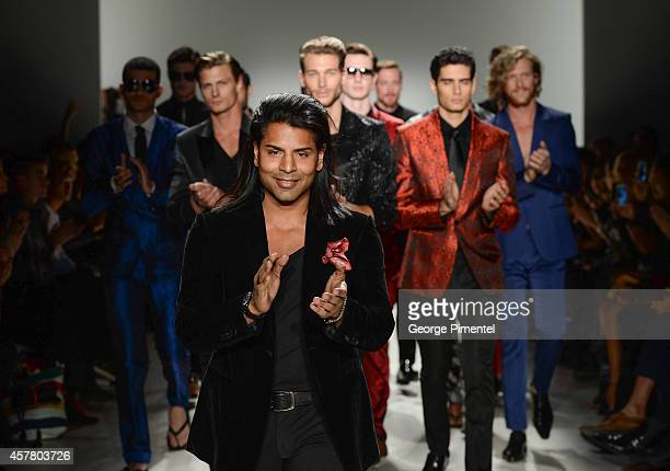 Designer Hussein Dhalla presents HD Homme spring 2015 collection during World MasterCard Fashion Week Spring 2015 at David Pecaut Square on October...