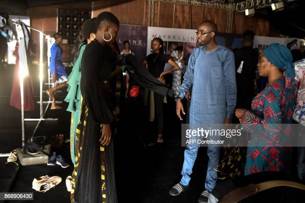 """Designer Ibrahim Aminu speaks to models backstage before his """"House of Kaya"""" fashion show during the Lagos Fashion and Design Week, on October 25,..."""
