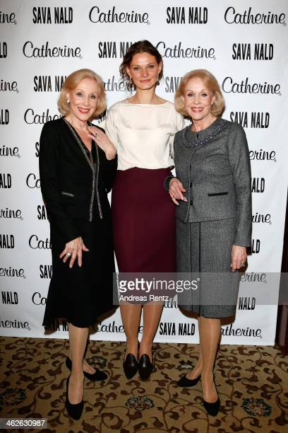 Designer Inna Thomas poses with Alice and Ellen Kessler at the Sava Nald show during the MercedesBenz Fashion Week Autumn/Winter 2014/15 at Hotel...