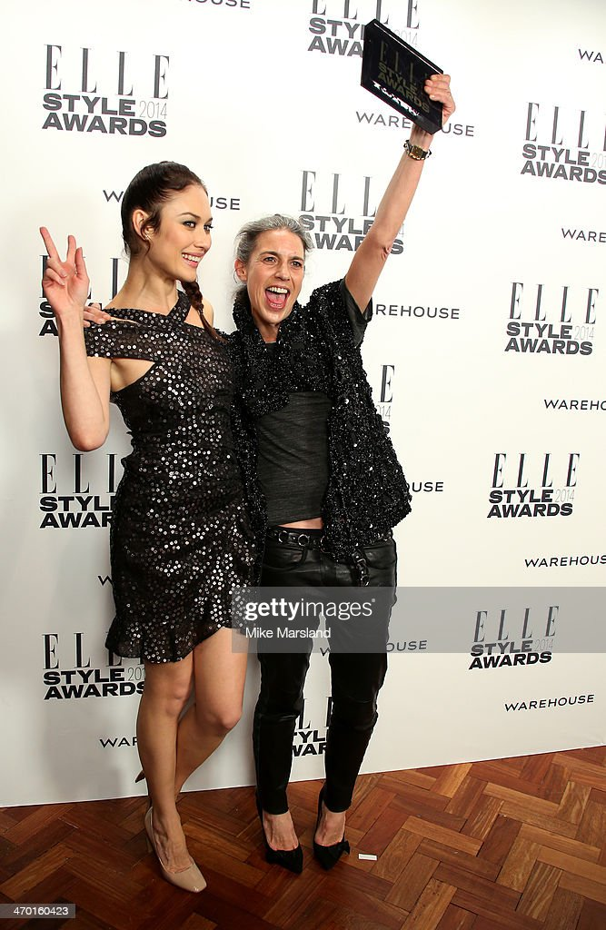 Designer Isabel Marant, winner of the Contemporary Designer of the Year Award, poses in the winners room with actress and presenter Olga Kurylenko at the Elle Style Awards 2014 at one Embankment on February 18, 2014 in London, England.