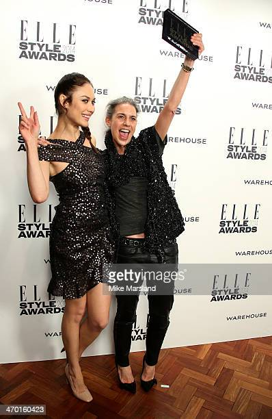 Designer Isabel Marant winner of the Contemporary Designer of the Year Award poses in the winners room with actress and presenter Olga Kurylenko at...