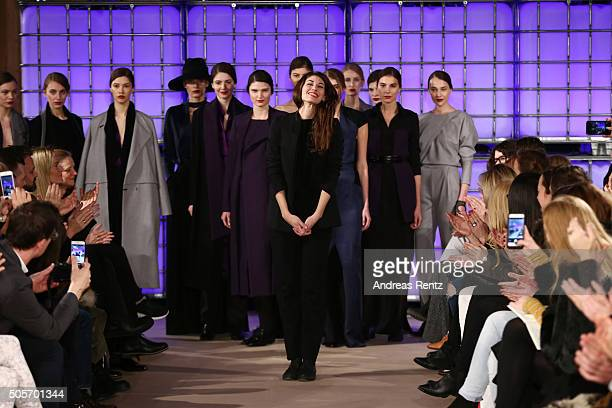 Designer Isabell de Hillerin acknowledges the applause of the audience after her show as part of Der Berliner Mode Salon during the MercedesBenz...