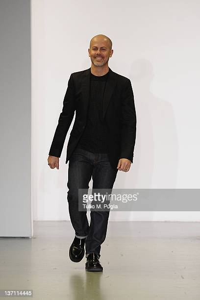 Designer Italo Zucchelli acknowledge the applause of the public after the Calvin Klein Collection fashion show as part of Milan Fashion Week Menswear...