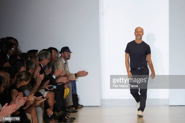 Designer Italo Zucchelli acknowledges the applause of the audience after the Calvin Klein Collection show as part of Milan Fashion Week Menswear...