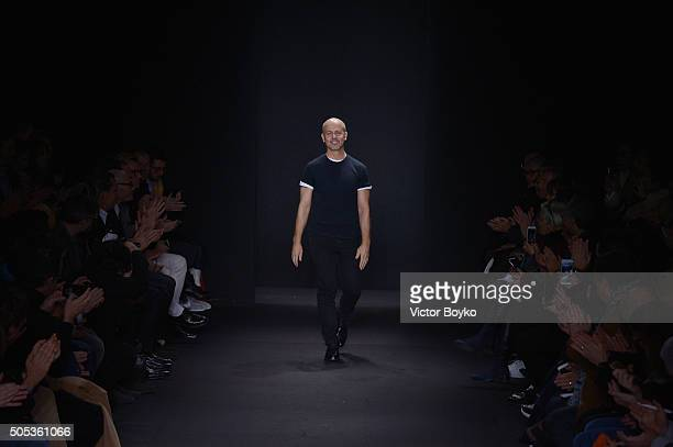 Designer Italo Zucchelli acknowledges the applause of the public after the Calvin Klein Collection show during Milan Men's Fashion Week Fall/Winter...