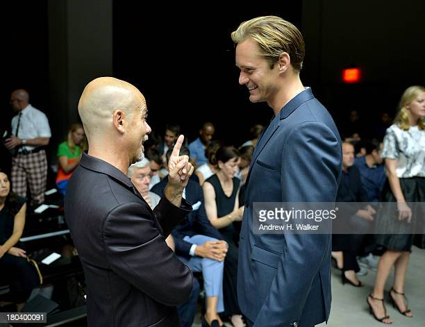 Designer Italo Zucchelli and actor Alexander Skarsgard attend the Calvin Klein Collection fashion show during MercedesBenz Fashion Week Spring 2014...
