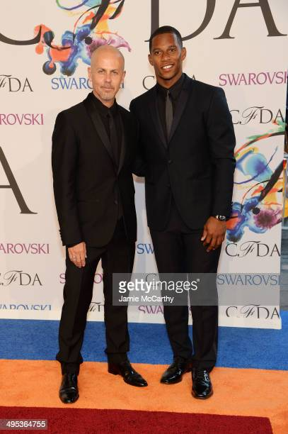 Designer Italo Zucchelli and NFL player Victor Cruz attend the 2014 CFDA fashion awards at Alice Tully Hall, Lincoln Center on June 2, 2014 in New...