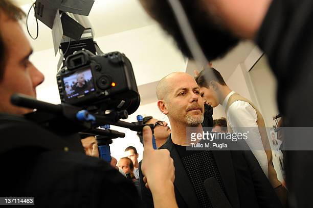 Designer Italo Zucchelli attends interview backstage prior to the Calvin Klein Collection fashion show as part of Milan Fashion Week Menswear...