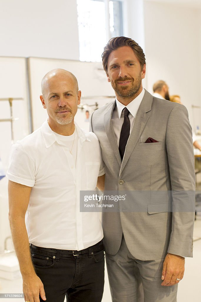 Designer Italo Zucchelli , left, and Henrik Lundqvist attend the Calvin Klein Collection show during Milan Menswear Fashion Week Spring Summer 2014 on June 23, 2013 in Milan, Italy.