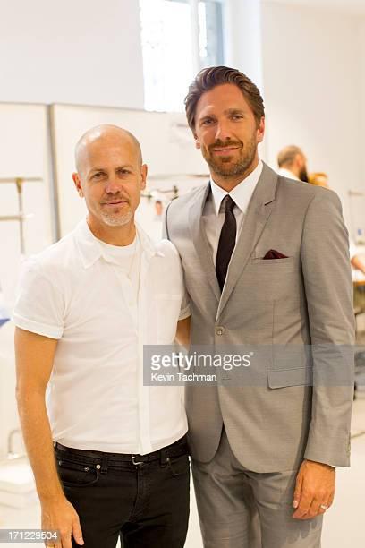 Designer Italo Zucchelli left and Henrik Lundqvist attend the Calvin Klein Collection show during Milan Menswear Fashion Week Spring Summer 2014 on...