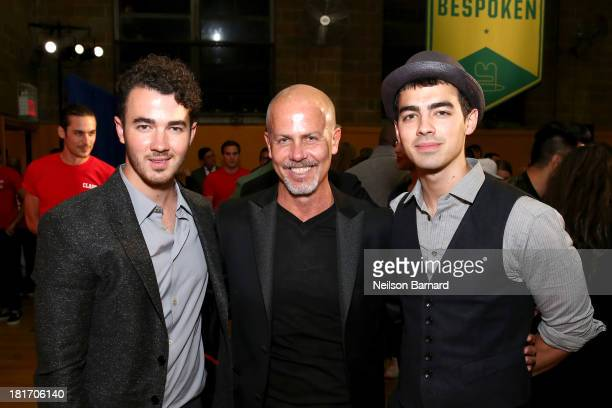Designer Italo Zucchelli of Calvin Klein poses with Joe Jonas and Kevin Jonas at the GQ Gap event to celebrate 2013 Best New Menswear Designers...