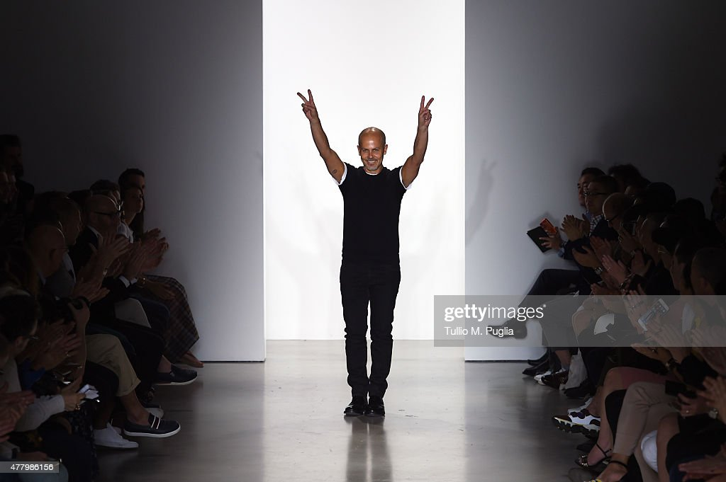 Designer Italo Zucchelli walks the runway after the Calvin Klein Collection show as part of Milan Men's Fashion Week Spring/Summer 2016 on June 21, 2015 in Milan, Italy.