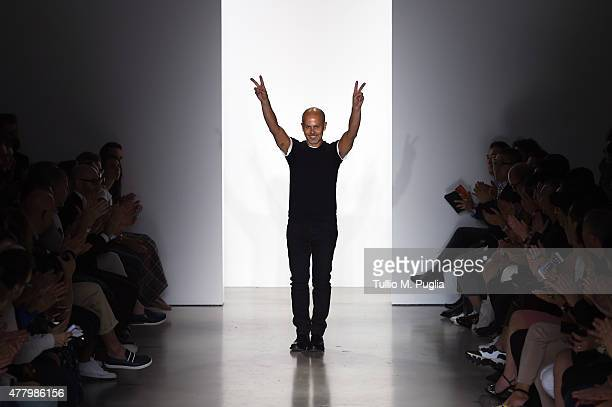Designer Italo Zucchelli walks the runway after the Calvin Klein Collection show as part of Milan Men's Fashion Week Spring/Summer 2016 on June 21...