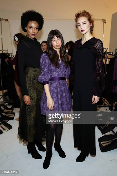 Designer Iyala Anne poses for a photo backstage with models in first looks before the Ane Amour fashion show during New York Fashion Week at Pier 59...