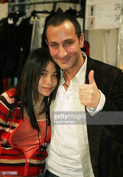 Designer J Mendel poses for a picture with his daughter Chloe backstage during the J Mendel Fall 2005 fashion show during Olympus Fashion Week at...