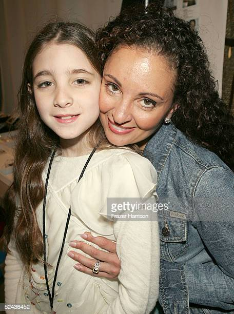 Designer Jacqueline Love with daughter Ambha Love backstage at the Shakti By Jacquelyne Love Fall 2005 show during the MercedesBenz Fashion Week at...