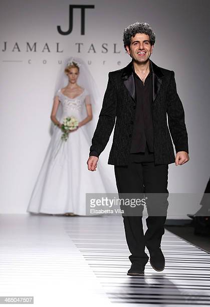 Designer Jamal Taslaq walks the runway during Jamal Taslaq S/S 2014 Haute Couture colletion fashion show as part of AltaRoma AltaModa Fashion Week at...