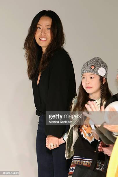 Designer Jane D'Haene walks the runway with models at the Anais I show during petitePARADE / Kids Fashion Week at Bathhouse Studios on February 28...