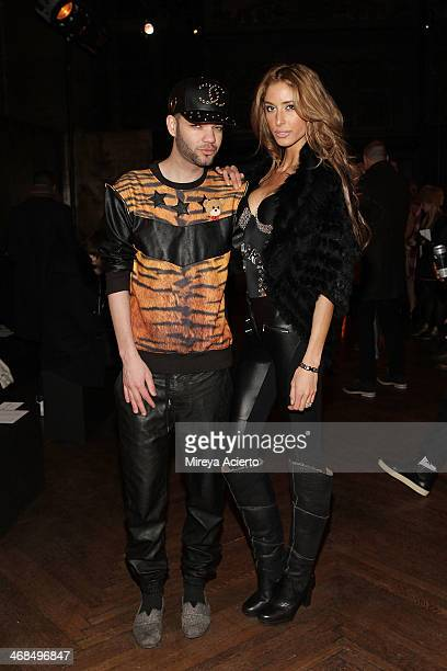 Designer Jason Christopher Peters and Mariela Perez attend the Billy Reid Men's fashion show during MercedesBenz Fashion Week Fall 2014 at The...