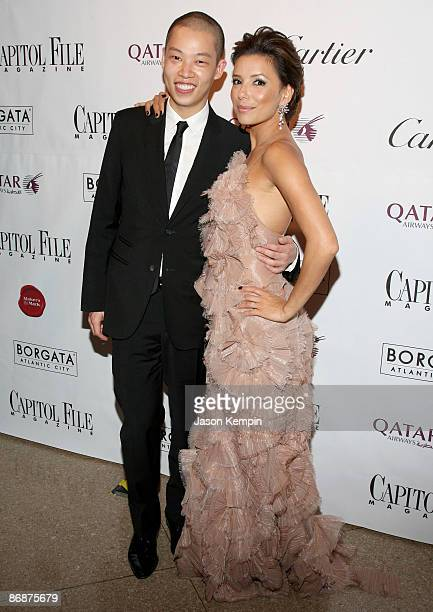 Designer Jason Wu and actress Eva Longoria walk the red carpet during the White House Correspondents' dinner after party hosted by Capitol File at...