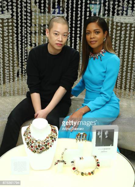 Designer Jason Wu and actress Naomie Harris poses for photos inside the Swarovski store during the 2017 Swarovski Star raising to the top of the...