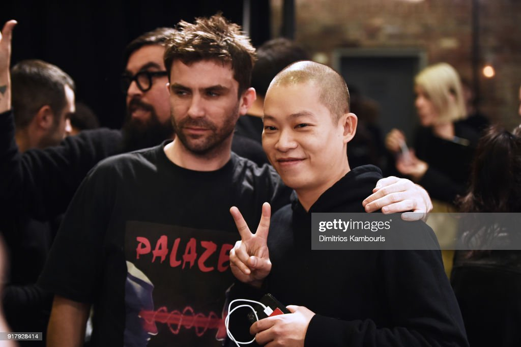 Designer Jason Wu (R) and guest pose backstage for BOSS Womenswear during New York Fashion Week at Cedar Lake on February 13, 2018 in New York City.