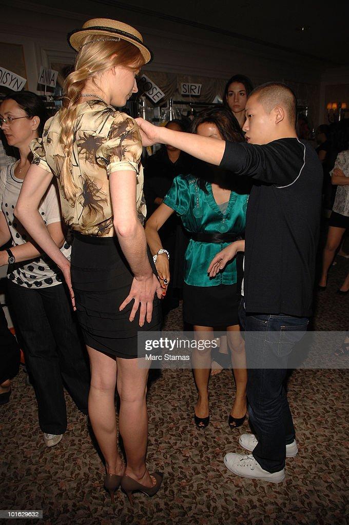 Designer Jason Wu completing final adjustments backstage at the Jason Wu Resort 2011 Collection at The St. Regis on June 4, 2010 in New York City.
