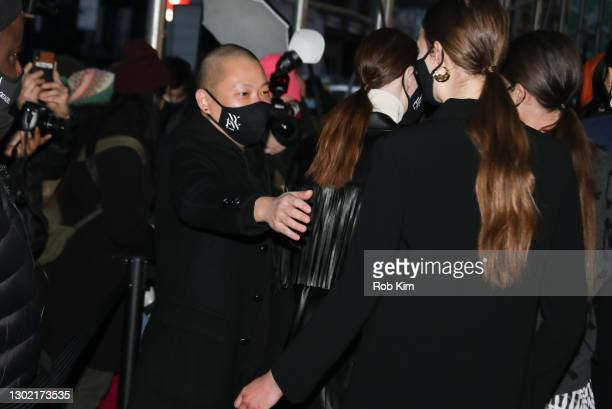 Designer Jason Wu meets with his models following his Jason Wu Fall 2021 collection show during New York Fashion Week: The Show on February 14, 2021...