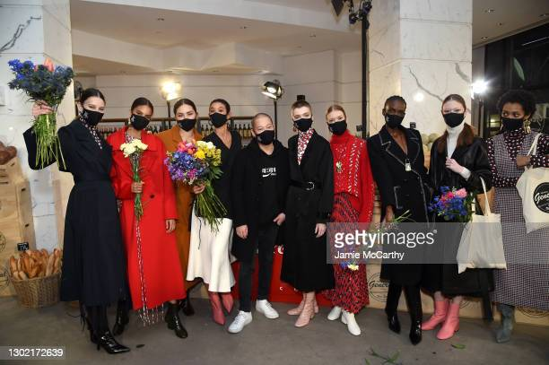 Designer Jason Wu poses with models backstage at the Jason Wu Runway during New York Fashion Week: The Shows on February 14, 2021 in New York City.