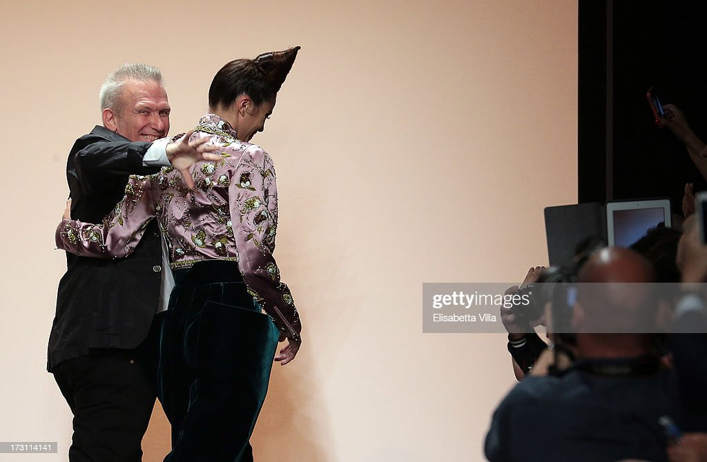 Designer Jean Paul Gaultier (L) acknowledges the public during his Houte Couture Paris fashion show as part of AltaRoma AltaModa Fashion Week at Santo Spirito in Sassia on July 7, 2013 in Rome, Italy.