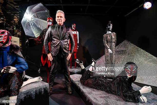 eb180748afa9 Designer Jean Paul Gaultier poses between his installations at the Swarovski  Kristallwelten store on September 15