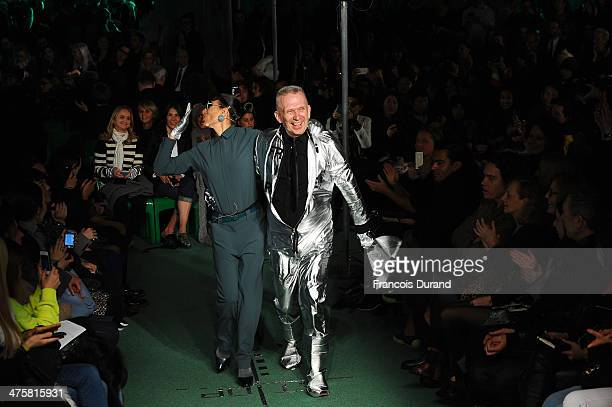 Designer Jean Paul Gaultier walks the runway alongside a model during the finale of the Jean Paul Gaultier show as part of the Paris Fashion Week...