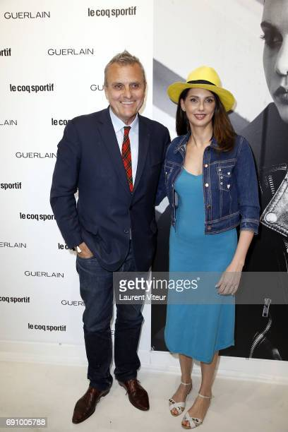 Designer JeanCharles de Castelbajac and Actress Frederique Bel attend 'Le Coq Sportif x Guerlain' at Le Coq Sportif Flagship on May 31 2017 in Paris...